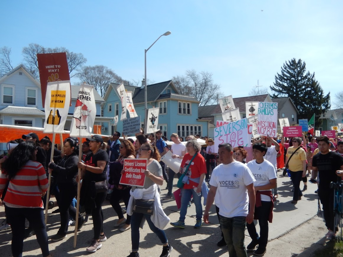 Protestors march through streets of Waukesha May 1 2018.png