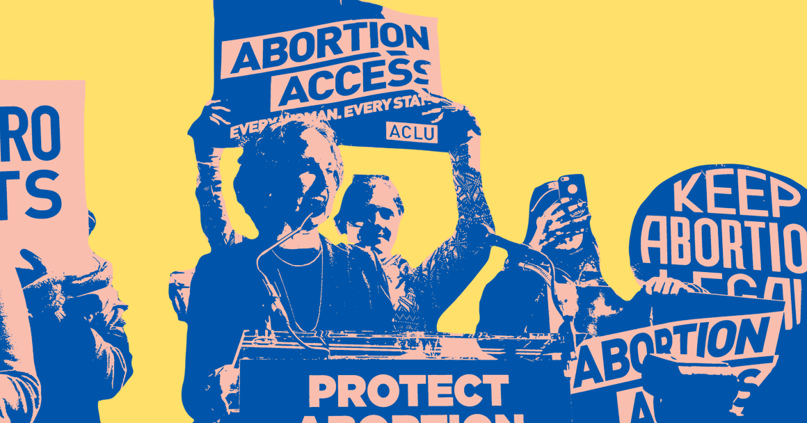 """Speaker standing at podium of pro-choice rally surrounded by people holding sings that read """"Protect Abortion"""" and """"Keep Abortion Legal."""""""